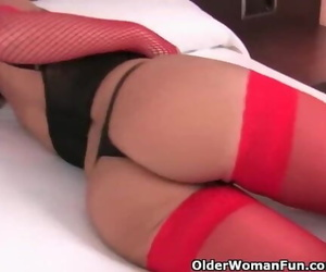 Warm Granny in Stockings and Undergarments Caresses her..