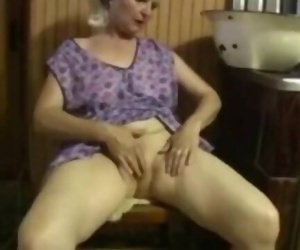 Old Lady uses Thick Dildo on herself