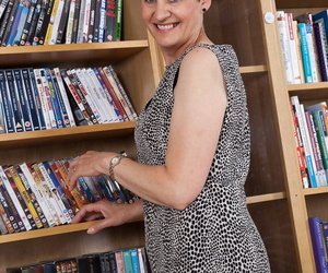 Mature librarian Dee showcases her petite natural hooters..