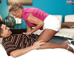 Horny granny Sandra Ann seducing junior guy in crotchless..
