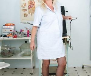 Salacious granny in nurse uniform revealing her rack and..