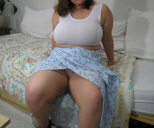 Big amateur exposes her fat orbs before pulling out a..