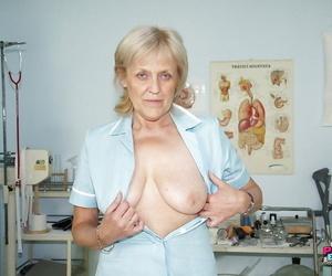 Blond granny in nurse uniform getting horny sitting on..