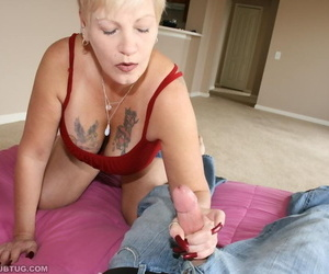 Brief haired amateur granny with tattooed rack gives a..