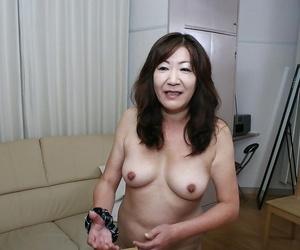 Naughty asian granny with pointy knockers and hairy vulva..