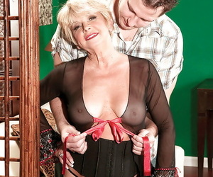 Blond granny DeAnna Bentley undressed by junior stud for..