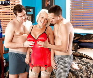 Buxomy ash-blonde granny Georgette Parks riding 1 guy and..