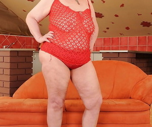 Fatty redhead granny with thick flabby tits taking off her..
