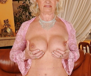 Lusty granny showcasing her fat jugs and fuzzy pouch..