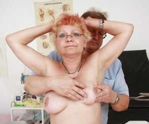Short-haired granny in stockings getting her honeypot..