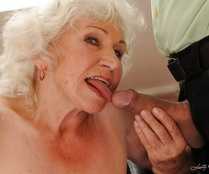 Jizz-starving granny in stockings gives head and gets..