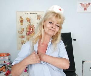 Mouthwatering granny in nurse uniform masturbating her..