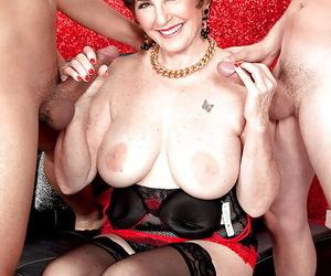 Bosomy granny in stockings Bea Cummins treats 2 cocks at..