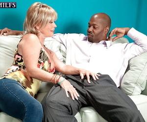 Blonde grandma Lexi McCain providing phat black cock oral..