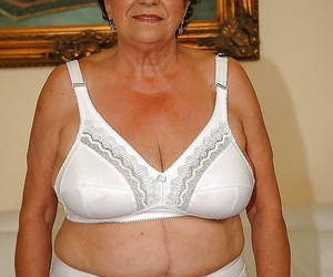 Fatty granny in undergarments gets bare to display her wet..