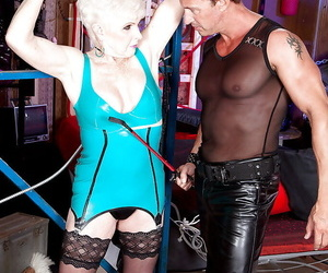 Latex dressed granny with saggy boobs engaging in hardcore..