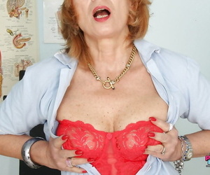 Nasty granny in captured stockings playing with a big nut..