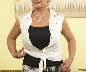 Chubby housewife over 50 holds a meaty orbs while pleasing..