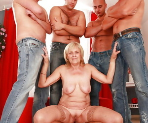 Lascivious granny gets blowbanged and pounded by four..