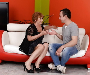 Redhead gran Sally G providing junior man oral lovemaking..