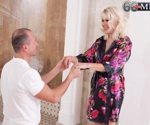 Warm blonde granny Lady S tempts her massagist in red bra..