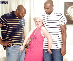 Slutty granny Jewel is into interracial groupsex with 2..