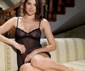 Absolutely stunning sol girl Anita E doffs sheer lingerie..