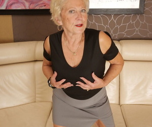 Promiscuous granny Marina T peels off off her clothes and..