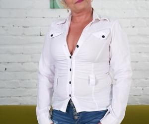 Glasses-clad mature granny Jessye sheds tight denim to..