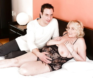 Blond granny with big saggy hooters taking jizz shot from..