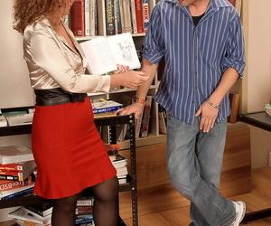Hot granny Demi La Rue presents a young boy to the..