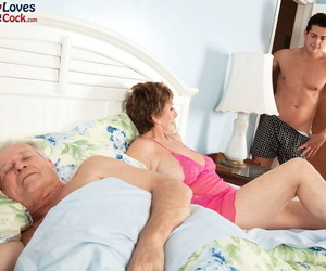 Brief haired granny Bea Cummins pounds a young guy while..
