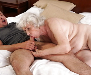 Grey haired granny Norma sucking off large cock to cumshot..