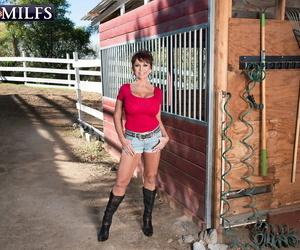 Warm granny Gina Milano seduces the ranchhand in cowgirl..