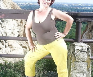 Wild granny revealing her fatty body with flabby hooters..