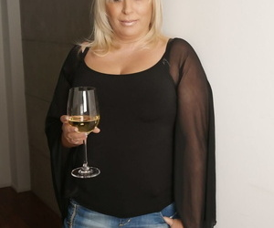 Light-haired mature Kirsa showcases off her BBW figure..