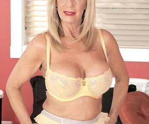 Ash-blonde Mummy Pheonix Skye wears blossom while shes..