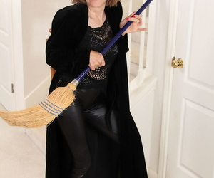 Old woman strips off her Witch attire before spreading her..