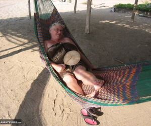 Obese nan Girdle Queen bares her large tits and huge belly..