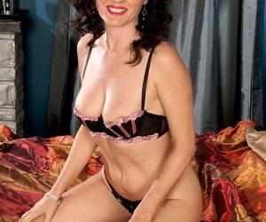 Mature brunette Danielle Reage lets a youthfull stud..