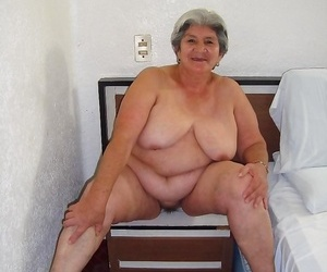 Nice granny eats her tits and makes striptease - part 476