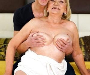 Irene deep-throats his dick while squashing his balls...