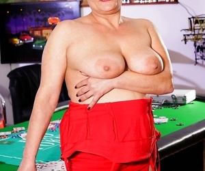 Horny granny dolly bee is toying cards with dangled stud..
