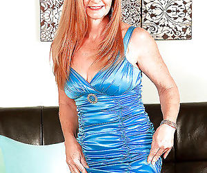 Mature redhead misty gold stripping bare and scoring rock..