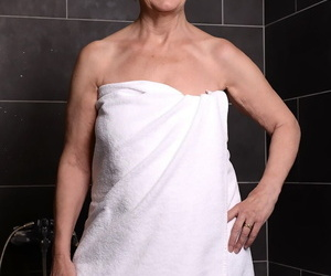 Fat short haired granny Margo T strips- showers & teases..