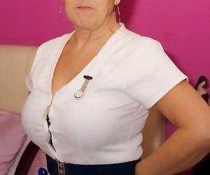 Mature nurse Savana undresses her uniform and lingerie in..