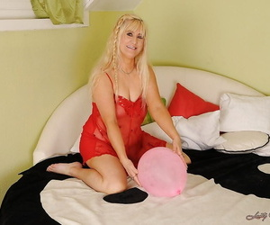 Chubby ash-blonde granny taking off her lingerie and..