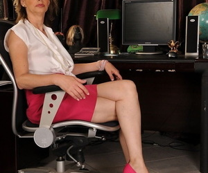 Lusty granny Judyt gets a youthfull stud to her office to..