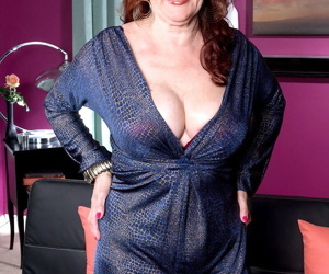 Hot granny Katherine shows saggy cleavage & thong upskirt..
