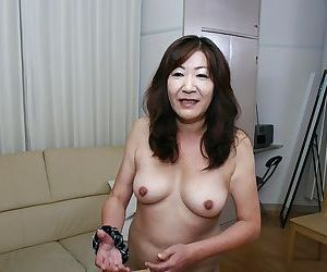 Naughty asian granny with pointy hooters and hairy..